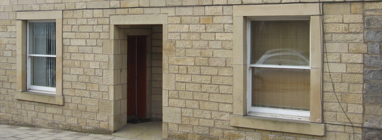Stone wall re-pointed